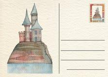 与城堡的手拉的后面明信片 免版税库存图片