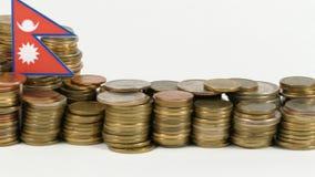与堆的尼泊尔旗子金钱硬币 影视素材