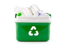 与塑料瓶、纸和其他塑料项目的一个回收站 免版税图库摄影