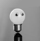 与塑料眼睛的电灯泡 免版税库存图片