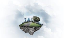 与塔和摩天大楼的现代都市风景la的绿色部分的 库存照片