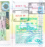 与塞浦路斯,爱尔兰的英国签证和邮票的护照 库存图片