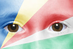 与塞舌尔群岛旗子的面孔 库存照片