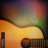 与声学吉他的抽象难看的东西背景 库存照片