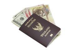 与外国钞票的泰国护照 免版税图库摄影