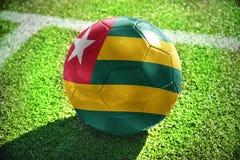 与多哥的国旗的橄榄球球 免版税库存照片