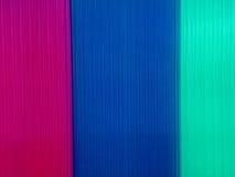 与多彩多姿的聚碳酸酯纤维板材的背景 库存照片