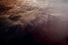 与夜空的被弄脏的星看起来象外层空间为背景 免版税库存图片