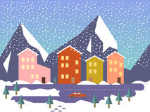 与大厦、街道和汽车礼物的冬天都市风景 免版税库存图片