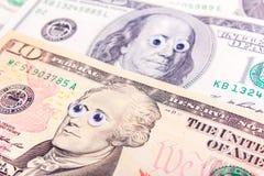 与大眼睛的美元 库存照片