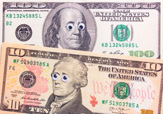 与大眼睛的美元 免版税库存照片