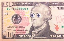 与大眼睛的美元 免版税库存图片