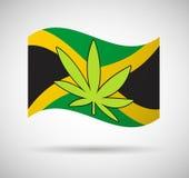 与大麻叶子的牙买加旗子 免版税库存照片