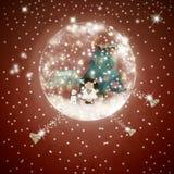 与天使和圣诞树的雪球玻璃 免版税库存图片