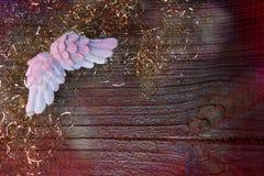 与天使翼的圣诞节背景 免版税库存图片