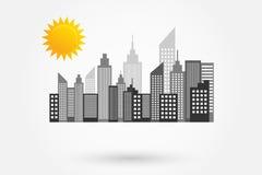 与太阳的现代城市摩天大楼地平线 图库摄影