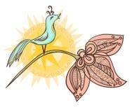 与太阳的装饰鸟在花 库存照片