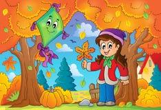 与女孩和风筝的秋天题材 库存图片