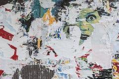 与女性面孔的被刮的海报 库存图片