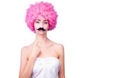 与女性/妇女/与桃红色假发的成人的可笑的图象 库存照片