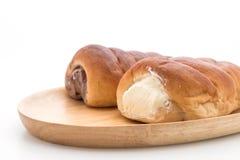 与奶油的小圆面包 免版税库存图片