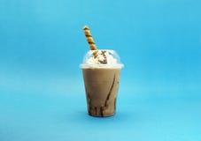 与奶油的热奶咖啡 库存照片