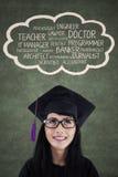 与她的梦想的年轻文凭 免版税库存照片