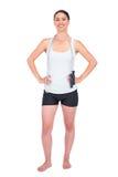 与她的跳绳的快乐的苗条模型在肩膀 免版税图库摄影