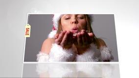 与妇女的广告吹在手的圣诞老人成套装备的 股票录像