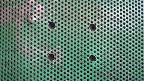与孔的绿色纹理金属 与孔的背景 库存照片
