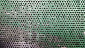 与孔的绿色纹理金属 与孔的背景 免版税库存图片