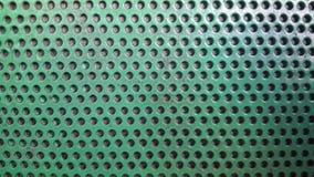 与孔的绿色纹理 与孔的背景 免版税库存图片