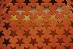 与孔的金属纹理以星的形式 图库摄影