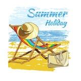 与字法,在沙子的可躺式椅的背景夏天与帽子 库存图片
