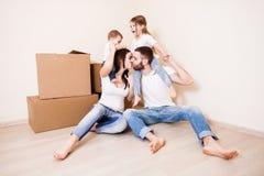 与孩子和移动的家庭 库存照片