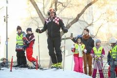 与孩子的伊维察Kostelic滑雪 库存照片