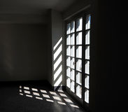 与它的阴影的玻璃拼花板门 库存照片