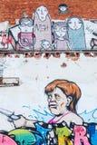 与安格拉・默克尔绘画的墙壁上的艺术品  库存图片