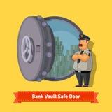 与官员卫兵的银行地下室室安全门 库存照片
