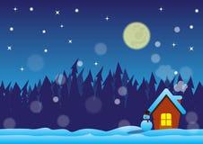 与家庭的圣诞夜在森林里 库存图片