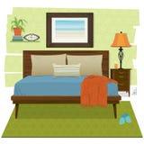 与家庭装饰的舒适卧室场面 免版税库存图片