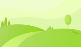 与导致天际的路的青山 绿色领域早晨风景 免版税图库摄影