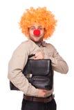 与小丑假发和鼻子的商人 免版税库存照片