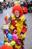 与小丑的狂欢节队伍 库存照片