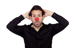 与小丑鼻子的吃惊的商人 库存照片