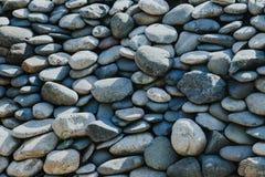 与小卵石的抽象背景 图库摄影