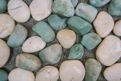 与小卵石的抽象背景 库存图片