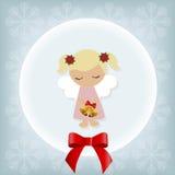 与小女孩天使的逗人喜爱的圣诞卡 免版税库存照片