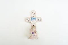 与小女孩的十字架 库存照片