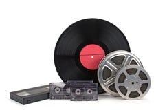 与小条、胶片、录音和唱片的老影片轴 免版税库存照片